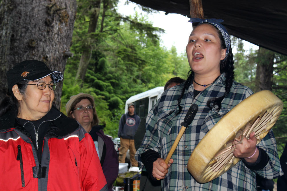 Tlingit language teaching assistant Teresa Moses shares a song at Culture Camp. (Photo by Nora Saks/KFSK)