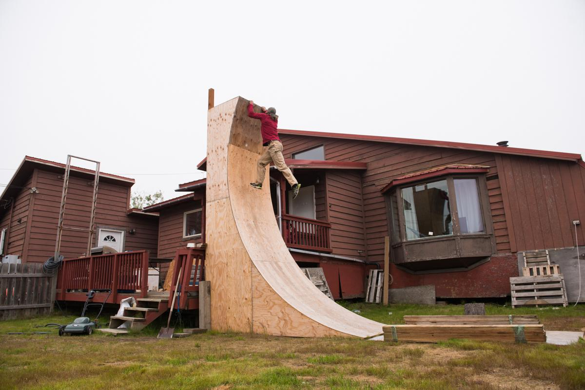"Nate DeHaan trains for ""American Ninja Warrior"" on a warped wall he built in his front yard in Bethel, Alaska. (Photo by Katie Basile/KYUK)"
