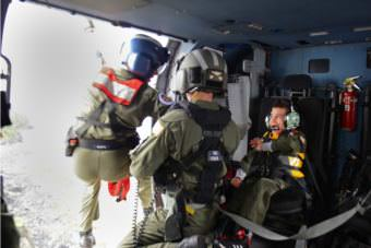 Andrew Bishop, 8, right, was named an honorary petty officer third-class by the U.S. Coast Guard Air Station Kodiak as part of his Make-A-Wish to be a rescue swimmer. (Photo by Meredith Manning/USCG)