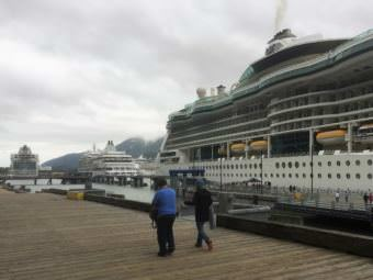 Passengers walk a downtown Juneau dock where three cruise ships are tied up June 11, 2017. (Photo by Ed Schoenfeld/CoastAlaska News)