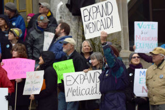 Supporters of Medicaid expansion braved foul weather in Juneau to express their views at the state Capitol, April 16, 2015. (Photo by Skip Gray/360 North)