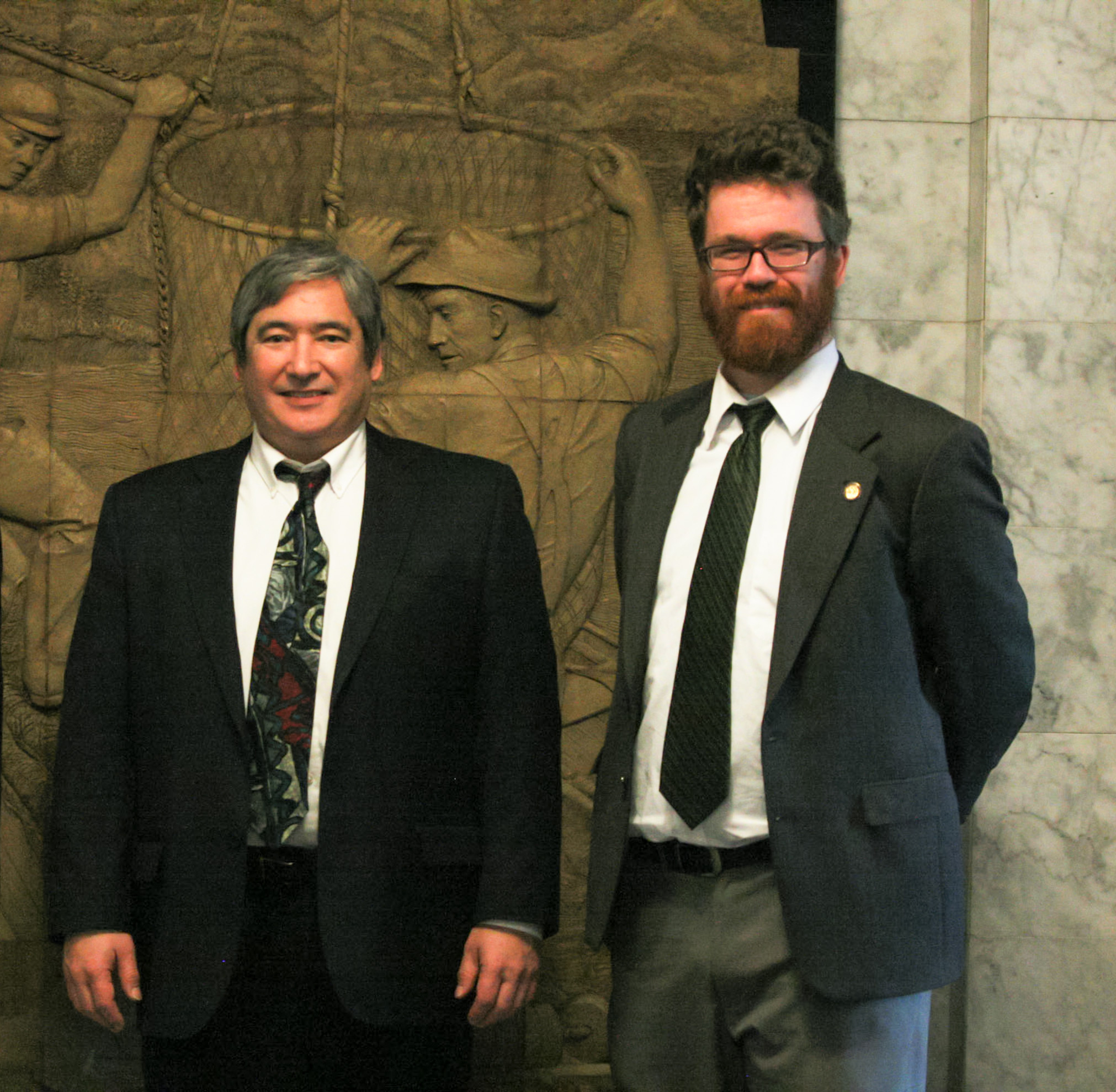 Rep. Sam Kito III (D-Juneau) and Rep. Justin Parish (D-Juneau) stand in the Capitol in February. They both say the Legislature accomplished some good in the legislative session, but has more work to do. (Photo courtesy office of Rep. Sam Kito)