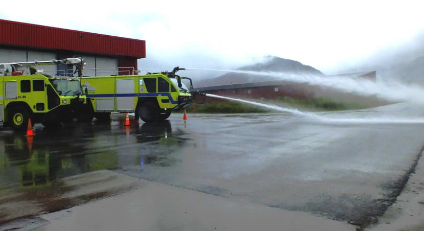 The newest ARFF vehicle at the Glacier Valley Fire Station carries 3,000 gallons of water, 400 gallons of foam, and 500 pounds of dry chemical which it can spray with two hose nozzles mounted on the front of the vehicle.