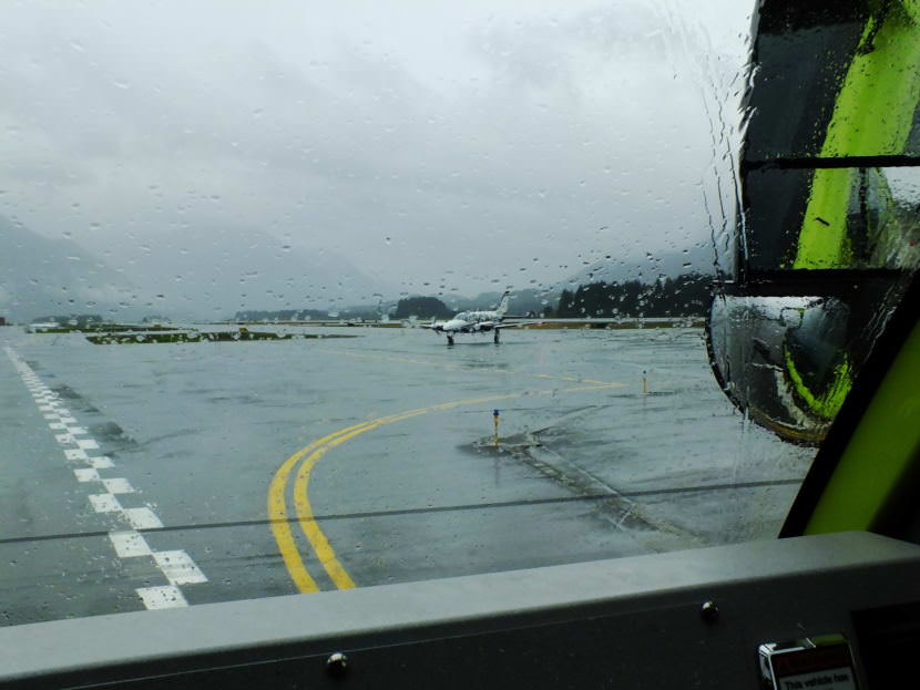 View from an inside of an ARFF vehicle as a Harris Air aircraft taxis off the runway to the ramp at Juneau International Airport.