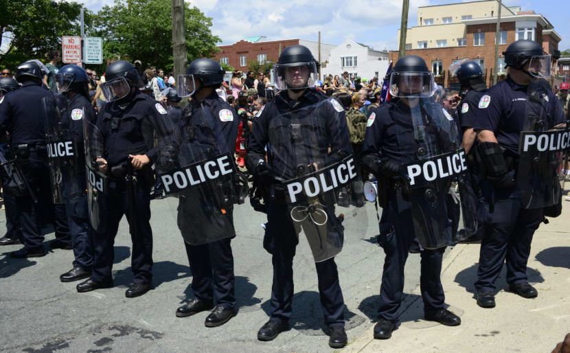 Police form a line near Emancipation Park in Charlottesville, Virginia, amid Unite the Right protesters and counterprotesters on Aug. 12, 2017.