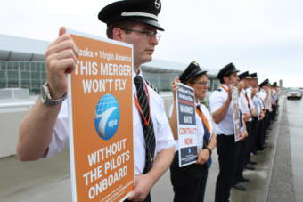 Pilots picket in front of Ted Stevens International Airport in support of Alaska Airlines' pilots request for a new contract. (Photo by Wesley Early/Alaska Public Media)