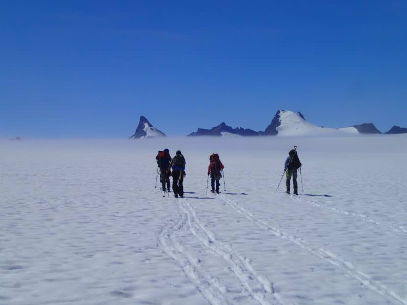Part of the mass balance group skiing to their pit located behind Emperor Peak. (Photo by Julian Cross, courtesy JIRP)