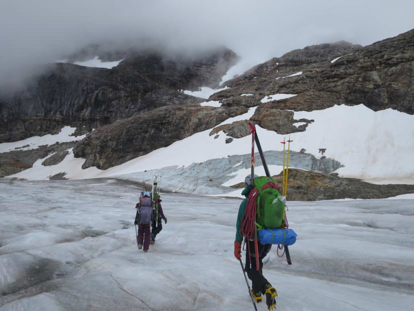 Students Zach Gianotti, Theresa Westhaver, and Ilana Casarez crossing the blue ice at the terminus of the Lemon Creek Glacier before a hike up Nugget Ridge. (Photo by Bryn Huxley-Reicher, courtesy JIRP)