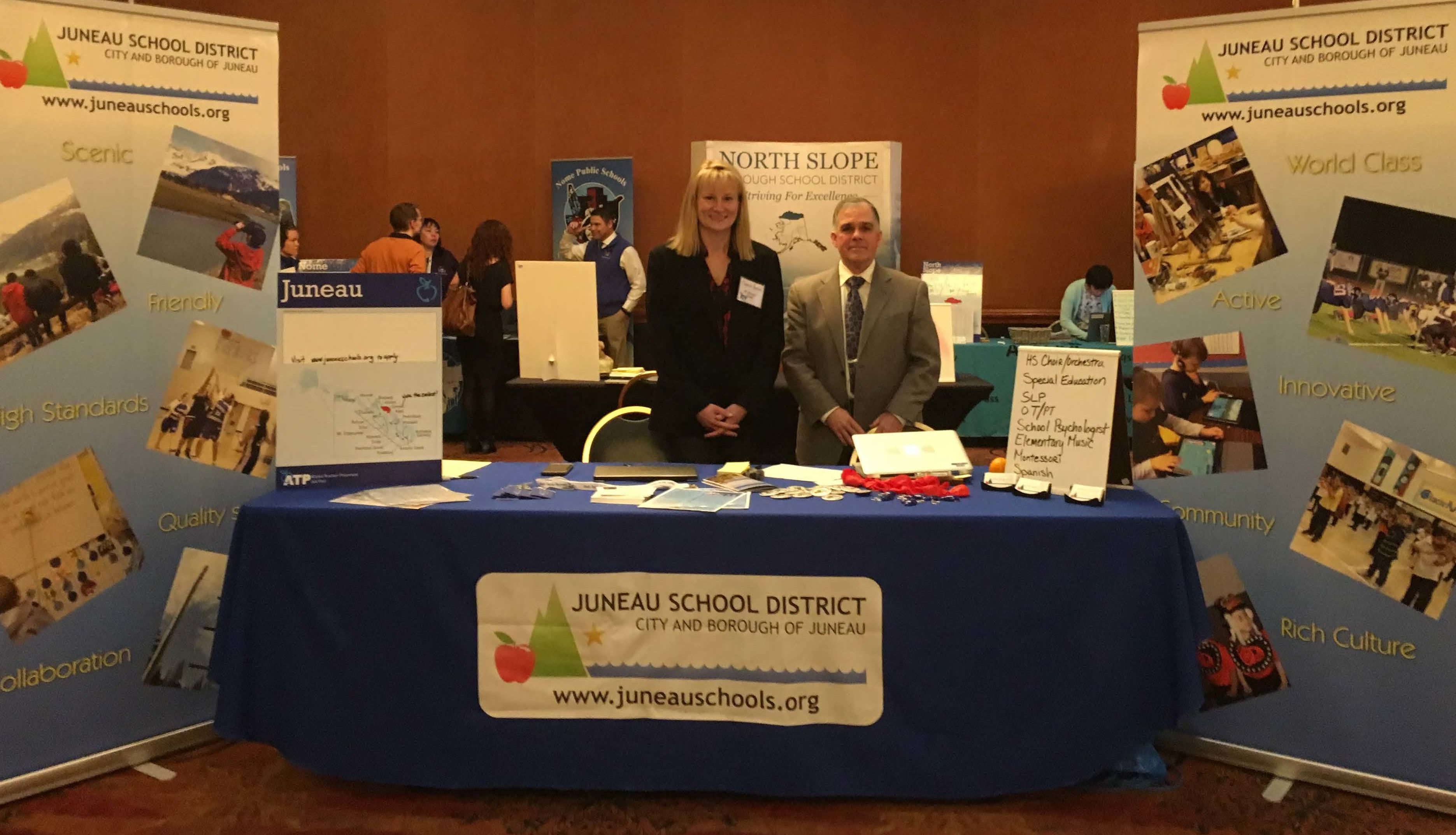 Juneau School District Human Resources Manager Cherish Hansen left, and recently retired Human Resources Director Ted VanBronkhorst at the Alaska Teacher Placement Job Fair in Anchorage, March 2017.