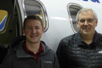 LifeMed Alaska CFO Jared Sherman, left, and LifeMed CEO Scott Kirby stand in front of a Learjet housed in Juneau on Friday, Aug. 11, 2017.