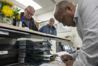 Alaska Gov. Bill Walker and Lt. Gov. Byron Mallott file for re-election with Daniel Ruiz, an administrative assistant with the Division of Elections, on Monday, August 21, 2017, in Juneau, Alaska. The two are filing as unaffiliated candidates -- though Mallott maintains his personal affiliation with the Democratic party. (Photo by Rashah McChesney/Alaska's Energy Desk)
