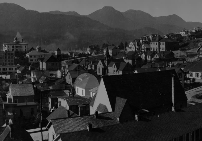Portion of a panoramic photo taken by Winter & Pond in 1916 at the corner of Third and Harris streets shows the old Church of the Holy Trinity in the foreground. The church's cross gable roof partially obscures the possible residences of Charles Damer and William Dickinson on Fourth Street. The highlighted structure may be the cottage where Charles Damer was murdered. Although the hip roof is identical to the roof of the existing structure at 325 Fourth Street, the ridge line runs in a different direction. (ASL-P87-1-002)