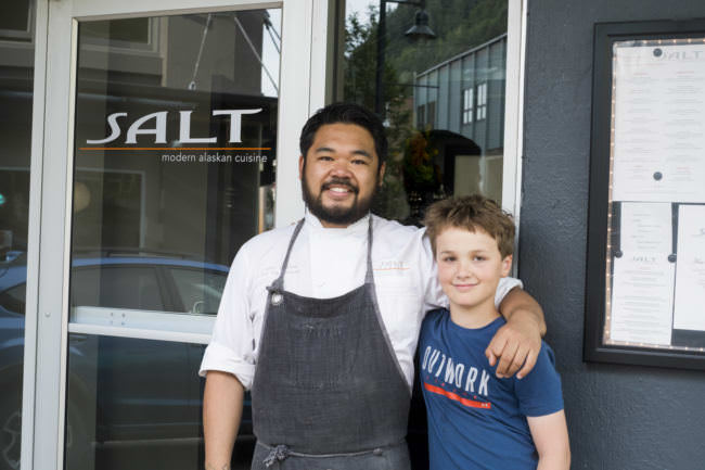 Chef Lionel Uddipa and Chopped Jr competitor Denali Schijvens stand outside of Salt on Aug. 10, 2017. Schijvens and Uddipa have been cooking together since Denali was 8. (Photo by Annie Bartholomew/KTOO)