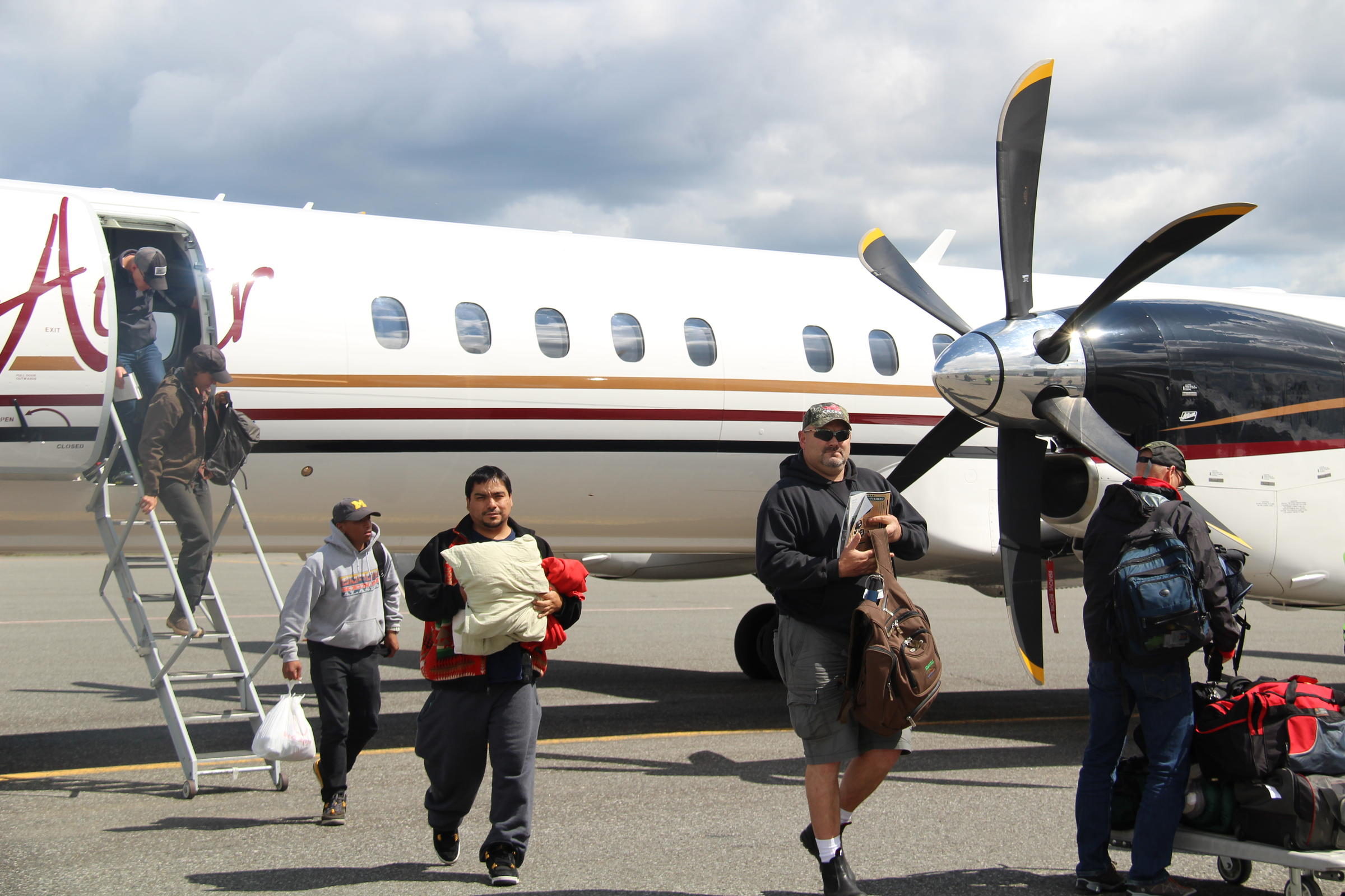 PenAir customers coming into Bristol Bay for the summer, deplaning one of the new Saab 2000s in King Salmon in June. (Photo by KDLG)