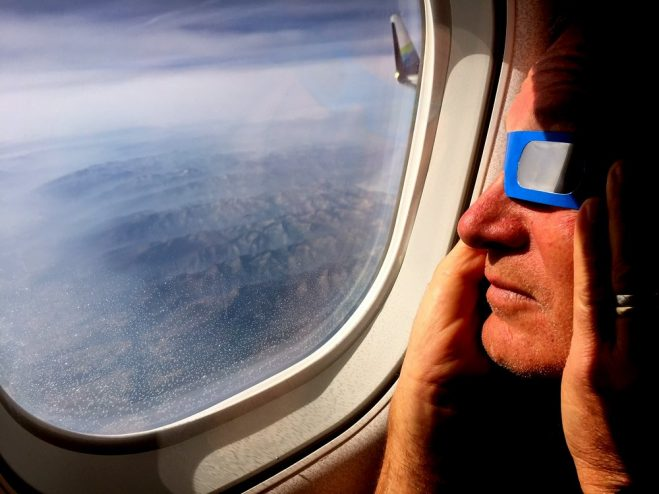 """Sitkan Brant Brantman takes in Monday's eclipse from the air between Portland and Minneapolis — a trip that was set in motion by listening to the song """"Why Does the Sun Shine?"""" as a child. (Photo by Cindy Edwards/KCAW)"""