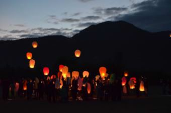 Community members released sky lanterns July 4, 2016, following a fatal crash that led to the cancellation of Petersburg's Independence Day celebration that year. (Photo by Orin Pierson/KFSK)