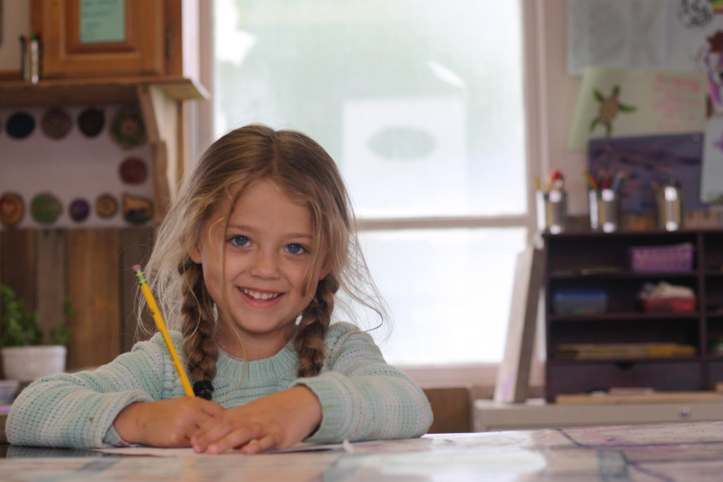 Mischaell Romo, 4, lives in the same building as the Dillingham Christian Youth Center. She's familiar with many of the youth who spend time there, and she's always looking for someone to draw, paint, or color with. (Photo by Zoey Laird/KDLG)