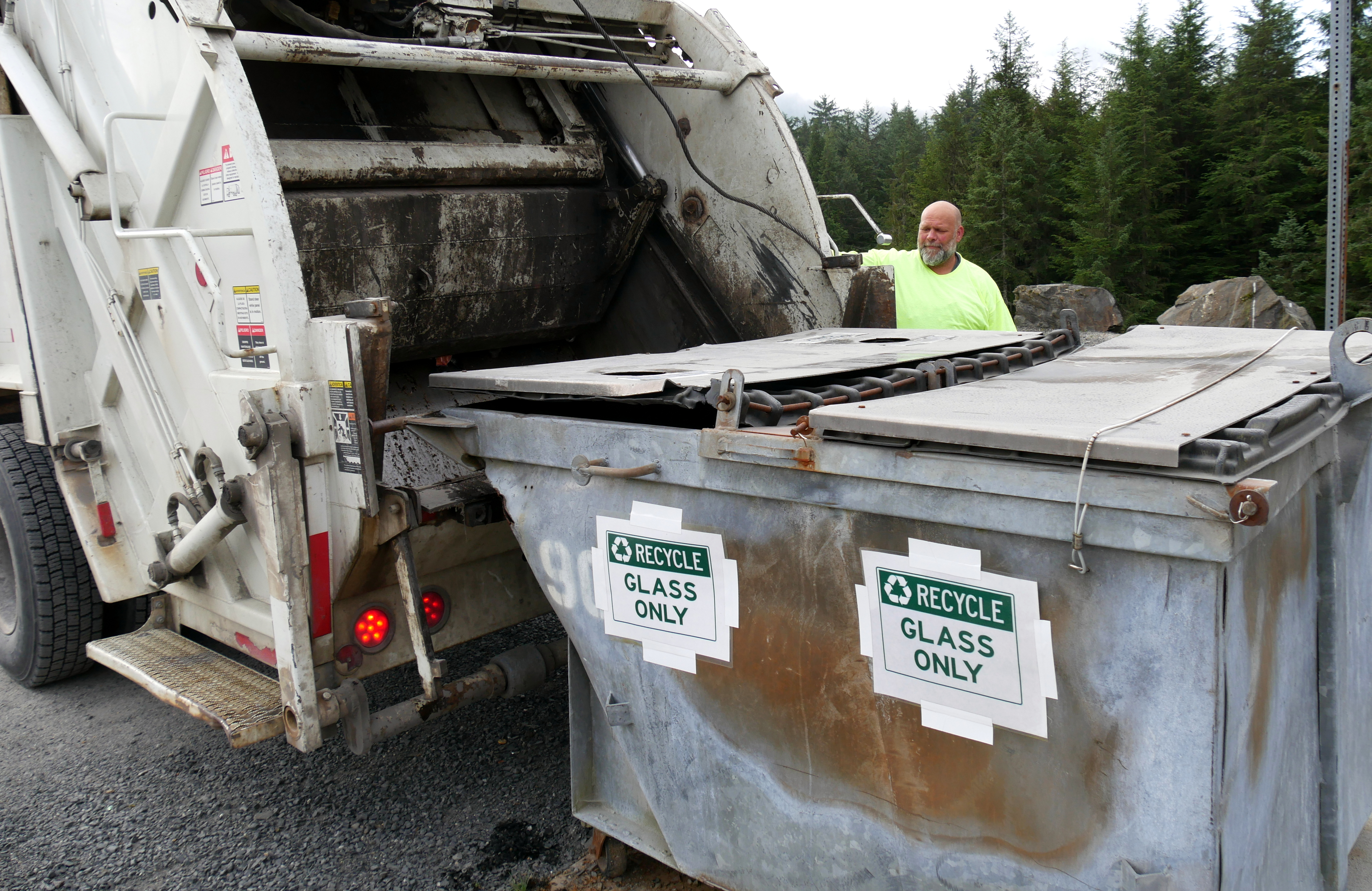 Petersburg Public Works employee, Kevin Granberg, loads glass into a dump truck to take to the landfill. (Photo by Angela Denning/KFSK)