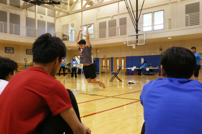 Kyle Worl demonstrates the Kneel Jump event for participants at the 2018 Traditional Games held at the University of Alaska Southeast Recreation Center. The contest was sponsored by Sealaska Heritage, Central Council of Tlingit and Haida Indian Tribes of Alaska and Wooch.Een in collaboration with Goldbelt Heritage. (Photo by Annie Bartholomew/KTOO)