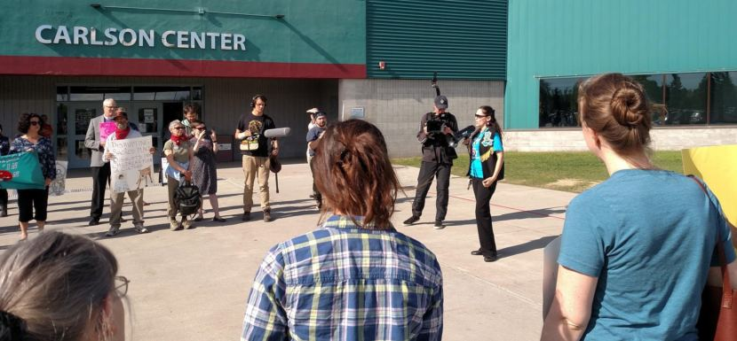 Fort Yukon Gwich'in Bernadette Demientieff, of the Gwich'in Steering Committee addresses protesters during their rally at the Carlson Center in Fairbanks on May 29, 2018. After the protest, they went inside and joined the meeting to offer testimony against opening ANWR's coastal plain to oil and gas development.
