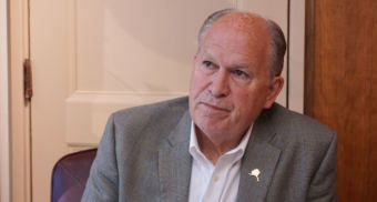 Alaska Gov. Bill Walker listens to a question from KTOO and Alaska Public Media reporter Andrew Kitchenman from his Capitol office in Juneau on June 19, 2018.