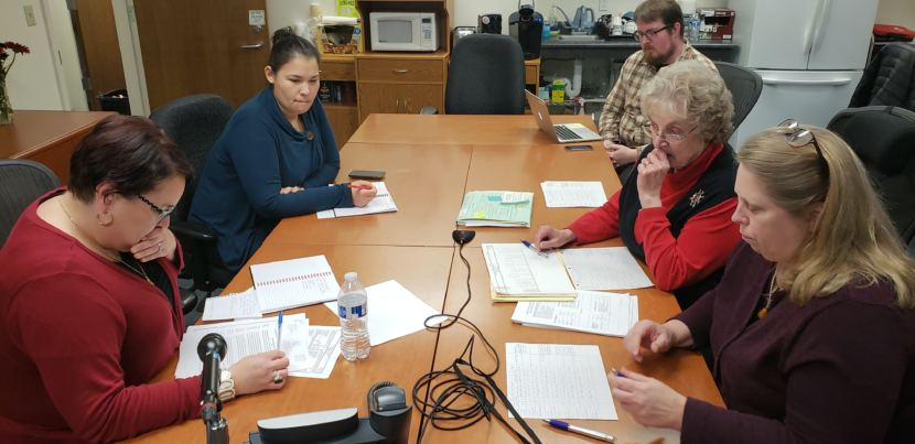 Alaska election officials hold a press conference over teleconference from the division's office in downtown Juneau on Nov. 26, 2018. Clockwise from bottom left: Elections Director Josie Bahnke, Elections Communication Manager Samantha Miller, Anchorage Daily News reporter James Brooks, State Review Board member Stuart Sliter, and State Review Board member Lynda Thater-Flemmer.