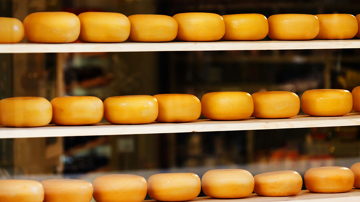 Rounds of cheese on-shelf