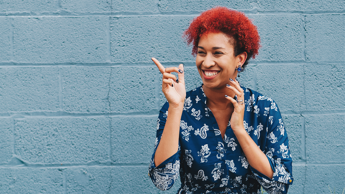 Brand-Led Culture: Woman smiling with red hair
