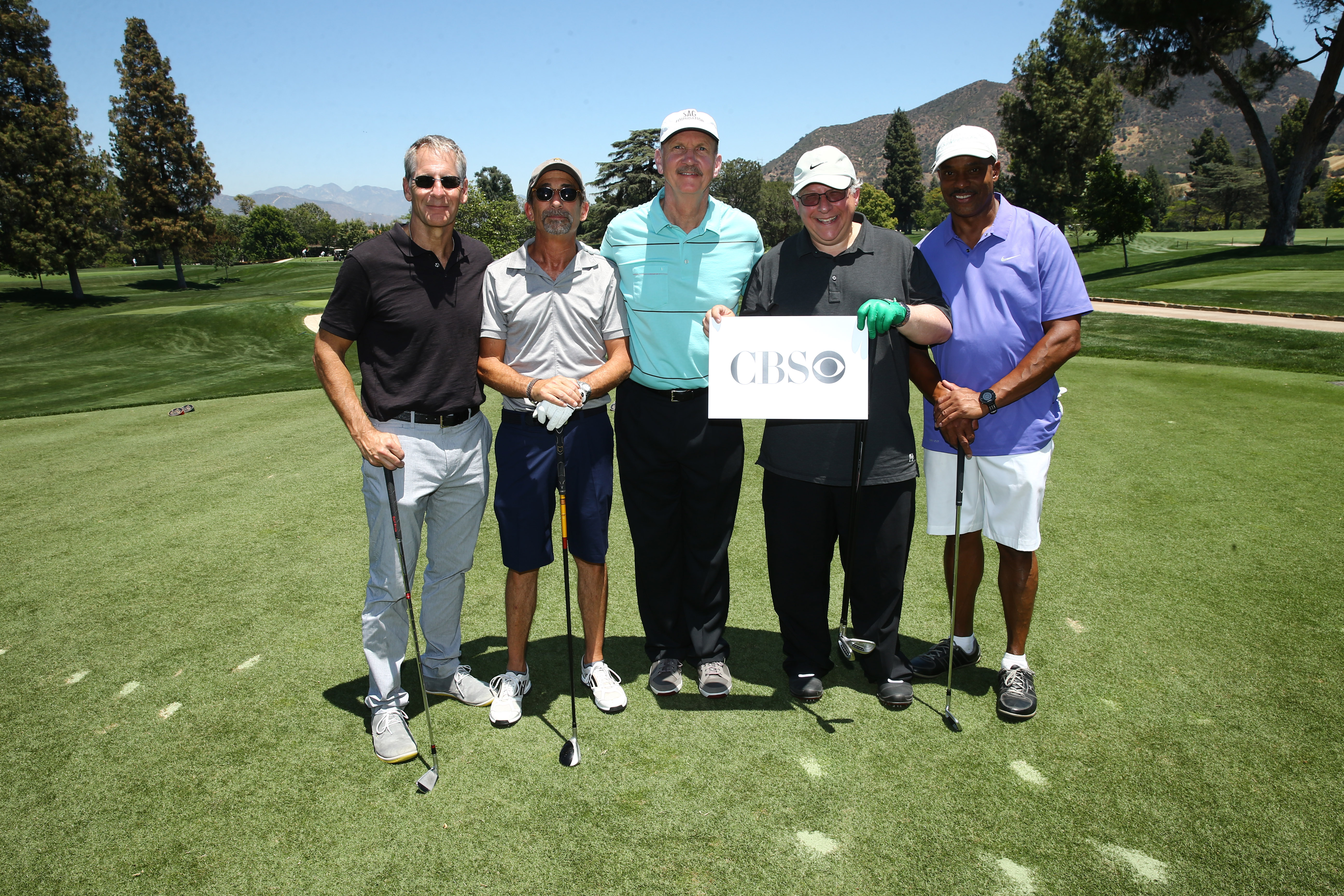 Scott Bakula, Jim Heyman, Michael O'Neill, Gary Glasberg and Rocky Carroll of Team CBS play at the Screen Actors Guild Foundation's 6th Annual Los Angeles Golf Classic on June 8, 2015 in Burbank, California. (Photo by Mark Davis/Getty Images for The Screen Actors Guild Foundation)