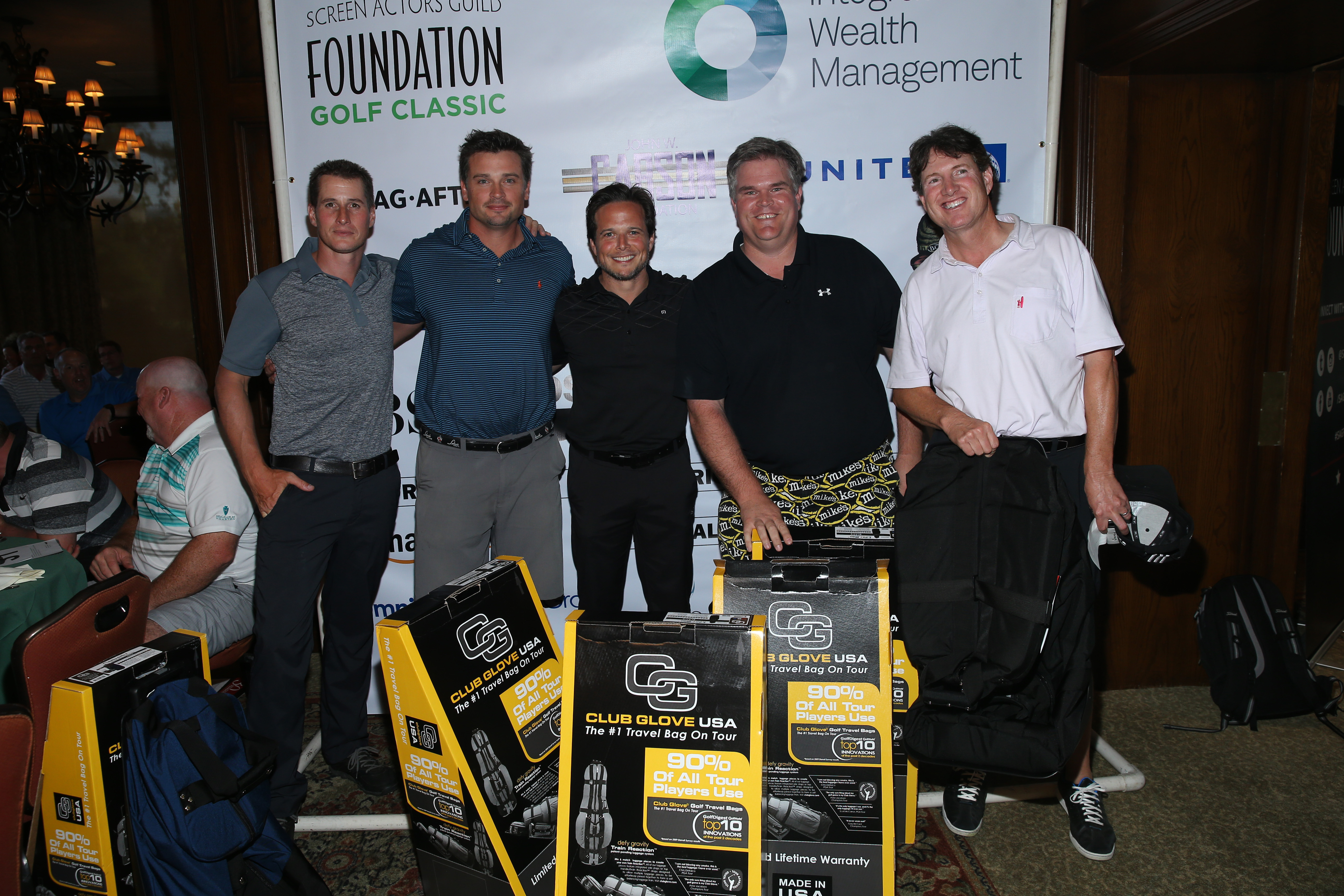 (L-R) Host Brendan Fehr, actor Tom Welling, host Scott Wolf and guests of Team John W. Carson, first place winners of the low net score, pose with prizes during The Screen Actors Guild Foundation's 6th Annual Los Angeles Golf Classic on June 8, 2015 in Burbank, California.  (Photo by Mark Davis/Getty Images for The Screen Actors Guild Foundation)