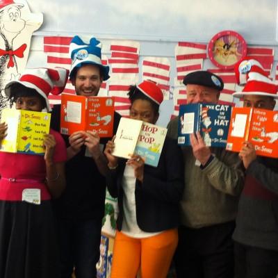 Volunteers celebrating Dr. Suess's birthday
