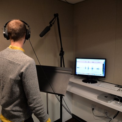 Backstage Editor Mark Peikert tests out  the EIF Voiceover Lab a try. Photo by Andrew Walker/Getty Images.