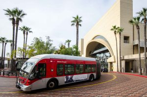 A Metro Rapid bus leaving the transit plaza.