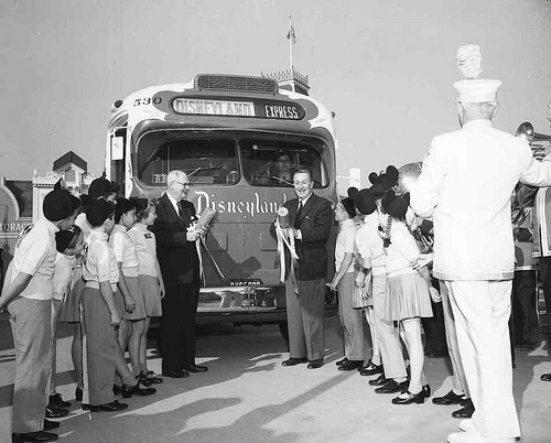 Metropolitan Coach Lines president Jesse Haugh, left, Walt Disney and Mouseketeers with Disneyland Express, 1955.