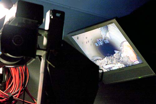 Tiny closed circuit television (CCTV) camera photographs the drains and see real-time images of debris