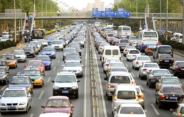 Cars line up in a traffic jam along a road in Beijing on May 12, 2010. The number of vehicles registered in Beijing picked up pace in early 2010, government figures showed, putting the Chinese capital on course to have five million cars on the roads by year's end. Photo: LIU JIN/AFP/Getty Images