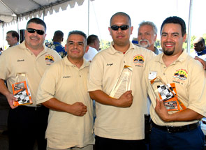Metro's champion mechanic team: David Klinkenborg, Javier Sora (coach), Angel Feria, and Jose Maya.