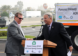 Caltrans District Director 7 Michael Miles and Los Angeles County Supervisor Don Knabe wrap the completion of the HOV Lane Project. Photo by Juan Ocampo.