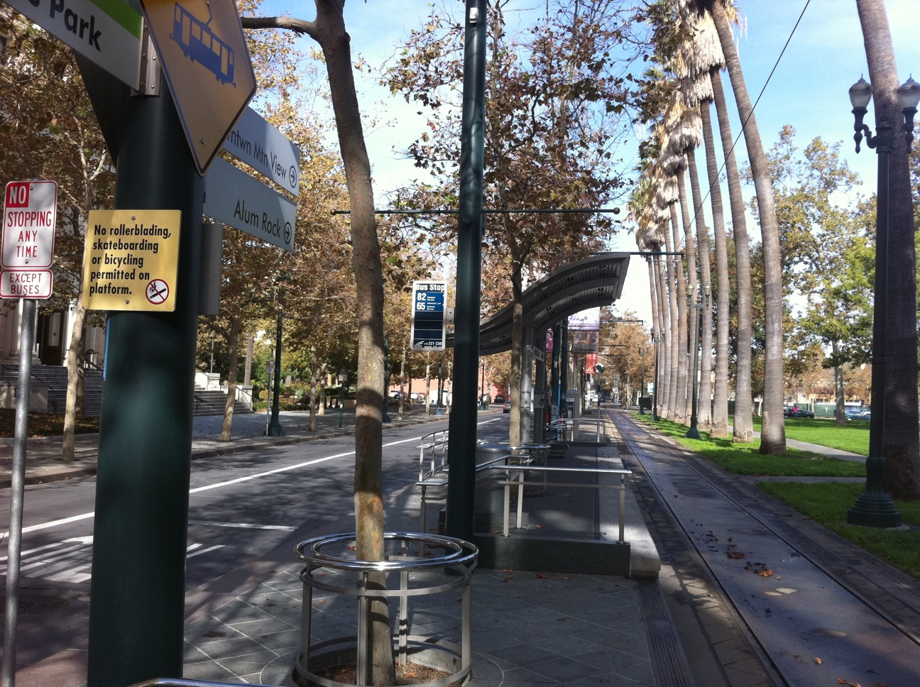 A multi-modal street in downtown San Jose serving light rail and buses in exclusive lanes, as well as private automobiles.