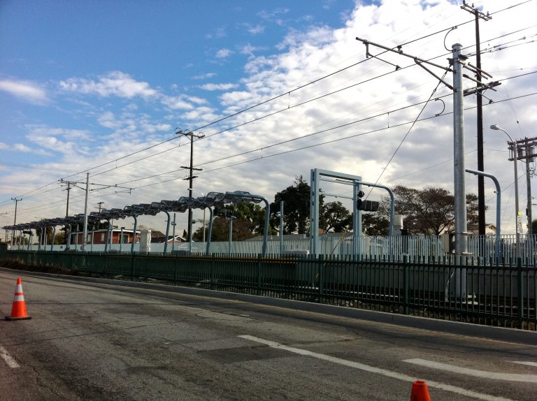 Catenary wire goes up over Crenshaw station.