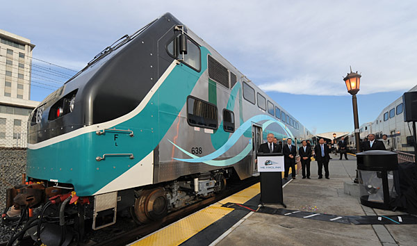 Metrolink CEO John Fenton at the launching of new Hyundai Rotem safety cars at Union Station platform in December 2010. Both Fenton, at podium, and Metrolink Board Chairman Richard Katz, background at left, will speak at the Steel Wheels conference. A similar platform exhibit is planned. (Photo by Gary Leonard)