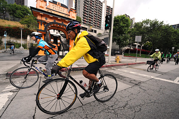 Cyclists ride past Angel's Flight on Hill Street. Photo by Gary Leonard