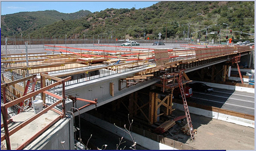 Workers have completed installing the deck panels on half of the Skirball Bridge and plan to pour the bridge deck this month.