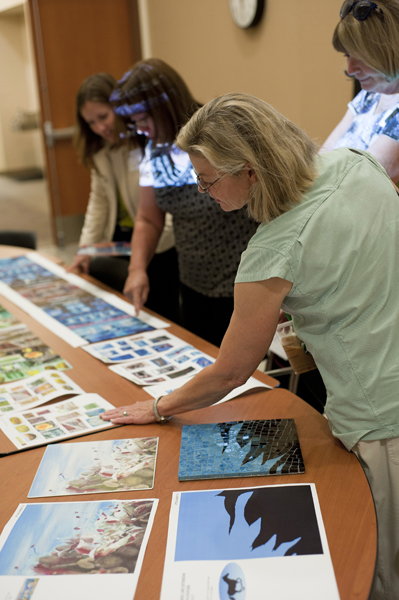 Art Advisory Group members view the artworks alongside samples of fabricated sections.