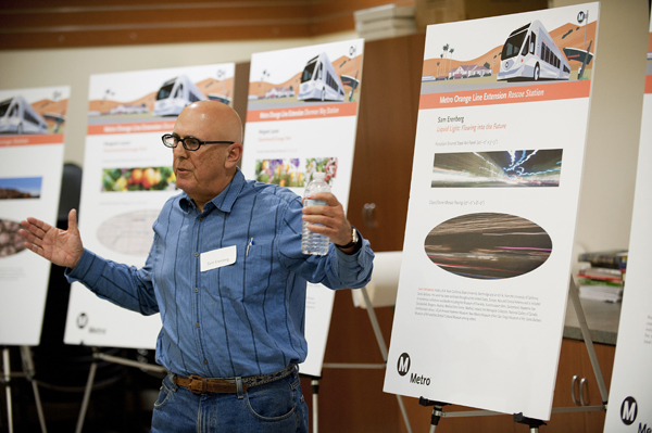 Sam Erenberg shares his final artwork designs for Roscoe Station with the Metro Orange Line Extension Art advisory Group.