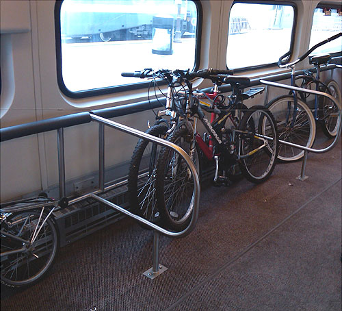 Metrolink retrofitted 10 trains with special railing to accommodate bikes on the train car's lower level.