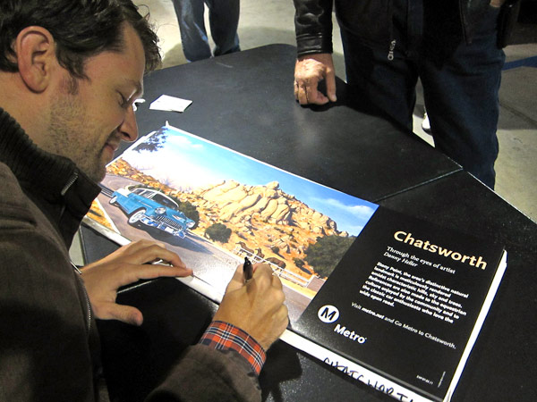 "Artist Danny Heller signs iconic ""Chatsworth"" poster commissioned by Metro in the ""Through the Eyes of Artists"" series."