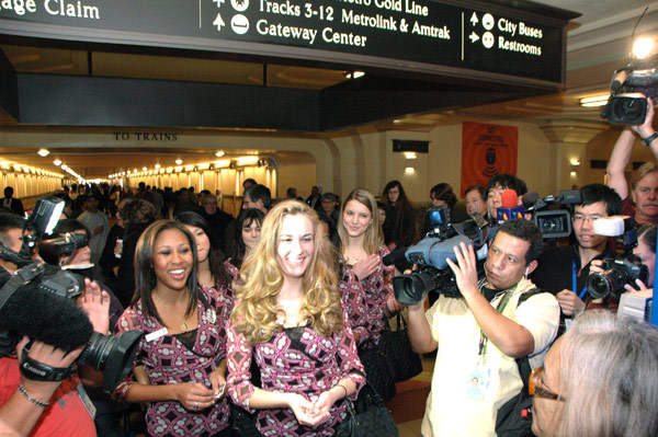 2012 Rose Queen Drew Helen Washington, at left, Princess Morgan Eliza Devaud and Princess Kimberly Victoria Ostiller greet transit patrons at Union Station. Photos by Luis Inzunza
