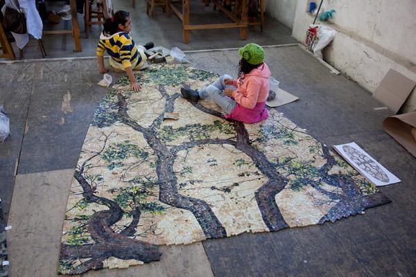 Artisans assembling the artwork