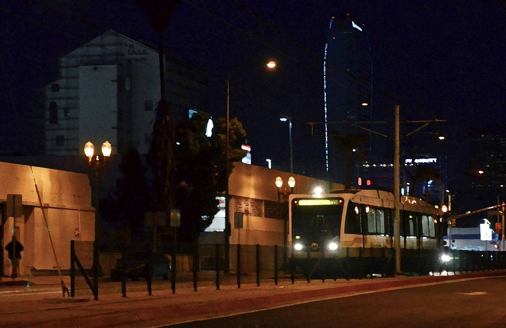 "A southbound Expo Line test train on Flower Street on Thursday evening. The ""dry brush"" effect was applied in Photoshop. Photo by Steve Hymon/Metro."